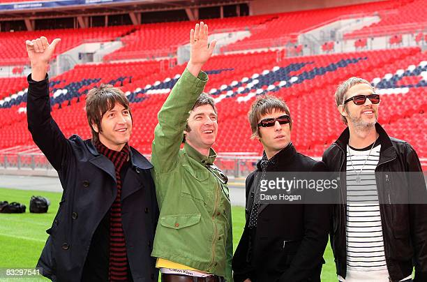 Gem Archer Noel Gallagher Liam Gallagher and Chris Sharrock attend the Oasis photocall in Wembley Stadium to promote their new album 'Dig out Your...