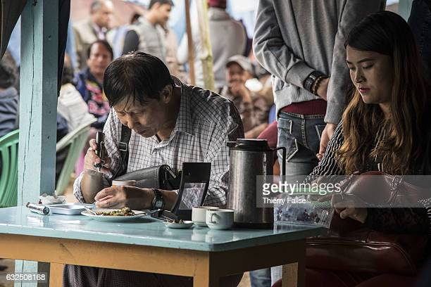 A gem dealer test the quality of a stone at Mogok main market