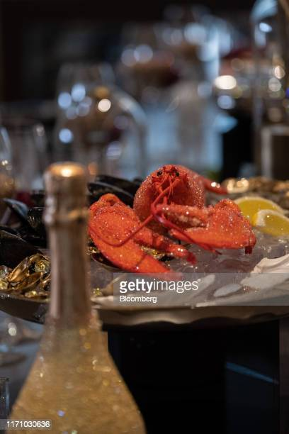 A gem encrusted lobster figurine manufactured by Swarovski AG sits on an ice display on board luxury superyacht Metis manufactured by Azimut Bentti...