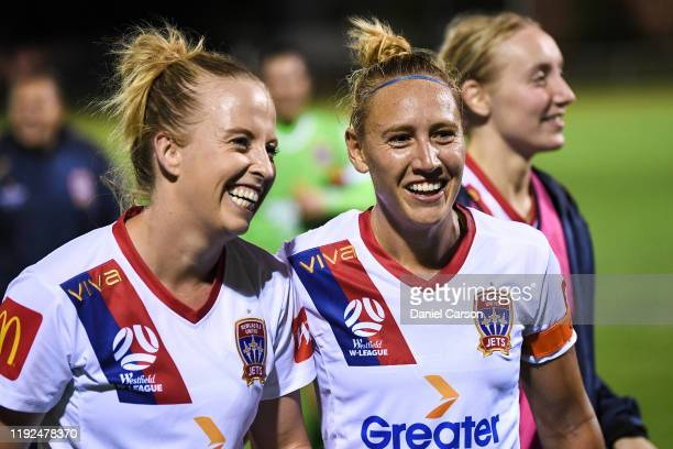 Gema Simon and Hannah Brewer of the Newcastle Jets celebrate the win during the round four W-League match between the Perth Glory and the Newcastle...