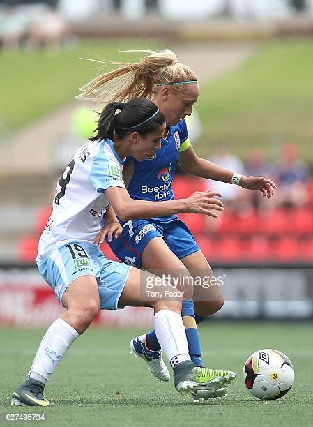 Gema Simon of the Jets contests the ball with Leena Khamis of Sydney during the round five WLeague match between the Newcastle Jets and Sydney FC at...