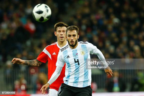 Geman Pessella of Argentina in action against Fedor Smolov of Russia during the international friendly match between Russia and Argentina at BSA OC...