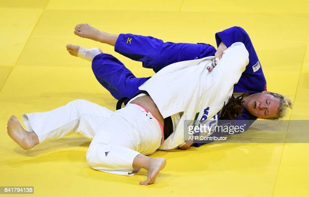 Gemany's Jasmin Kuelbs competes with Turkey's Kayra Sayit during their match in the womens 78kg category at the World Judo Championships in Budapest...