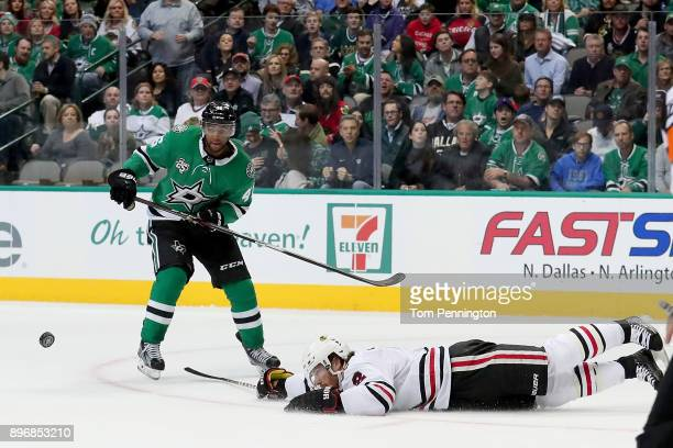 Gemel Smith of the Dallas Stars battles for the puck against Nick Schmaltz of the Chicago Blackhawks in the first period at American Airlines Center...