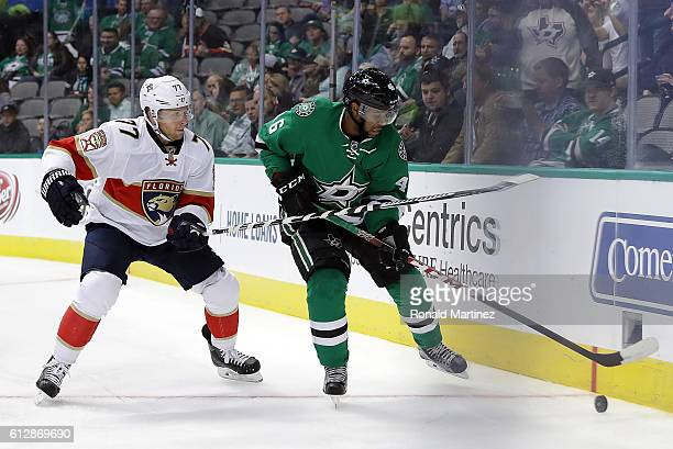 Gemel Smith of the Dallas Stars skates the puck against Steven Kampfer of the Florida Panthers during a preseason game at American Airlines Center on...