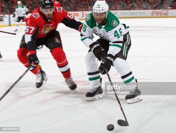 Gemel Smith of the Dallas Stars stickhandles the puck against Ben Harpur of the Ottawa Senators at Canadian Tire Centre on March 16 2018 in Ottawa...