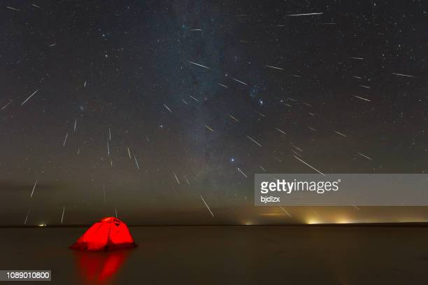 gemini meteor shower 2018 over lake in erenhot, inner mongolia, china - geminid meteor shower stock pictures, royalty-free photos & images