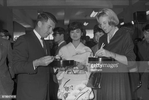 Gemini7 spaceman Wally Schirra has little difficulty eating Japanese style with chopsticks during a luncheon while visiting Sophia University Borman...