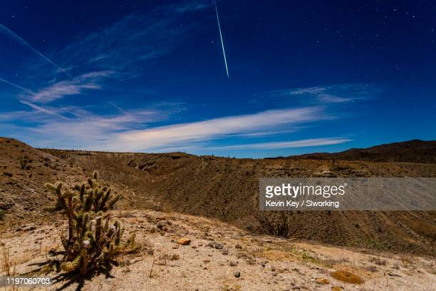geminid meteor fireball over the anza-borrego desert. - geminid meteor shower stock pictures, royalty-free photos & images