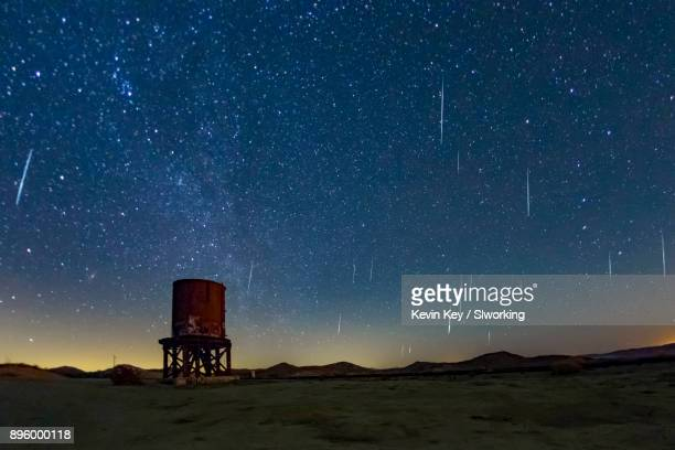 Geminid Meteor Shower 2017. Old railroad water tower in the foreground.