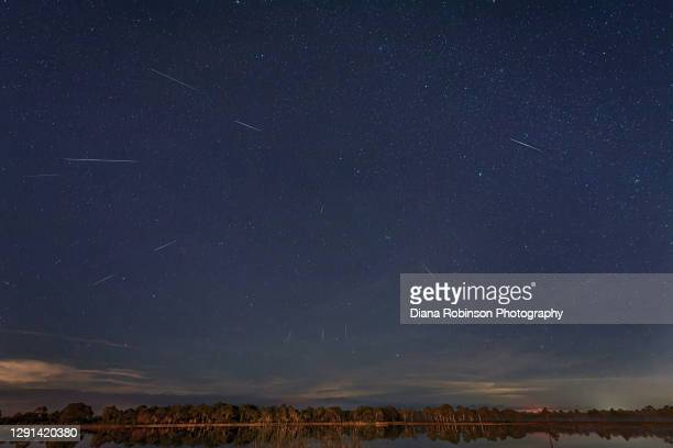geminid meteor shower over webb lake in fred c. babcock/cecil m. webb wildlife management area near punta gorda, florida - geminid meteor shower stock pictures, royalty-free photos & images