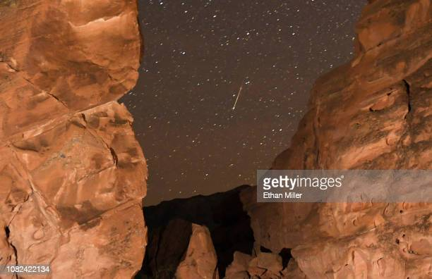 Geminid meteor streaks between peaks of the Seven Sisters rock formation early on December 14, 2018 in the Valley of Fire State Park in Nevada. The...