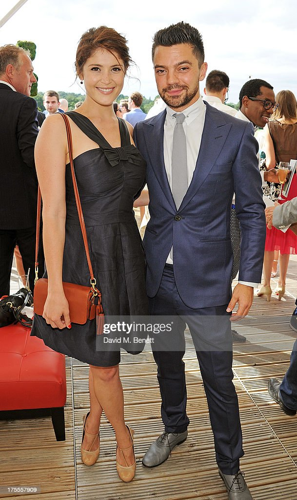 Gemma Arterton (L) and Dominic Cooper attend day 2 of the Audi Polo Challenge at Coworth Park Polo Club on August 4, 2013 in Ascot, England.
