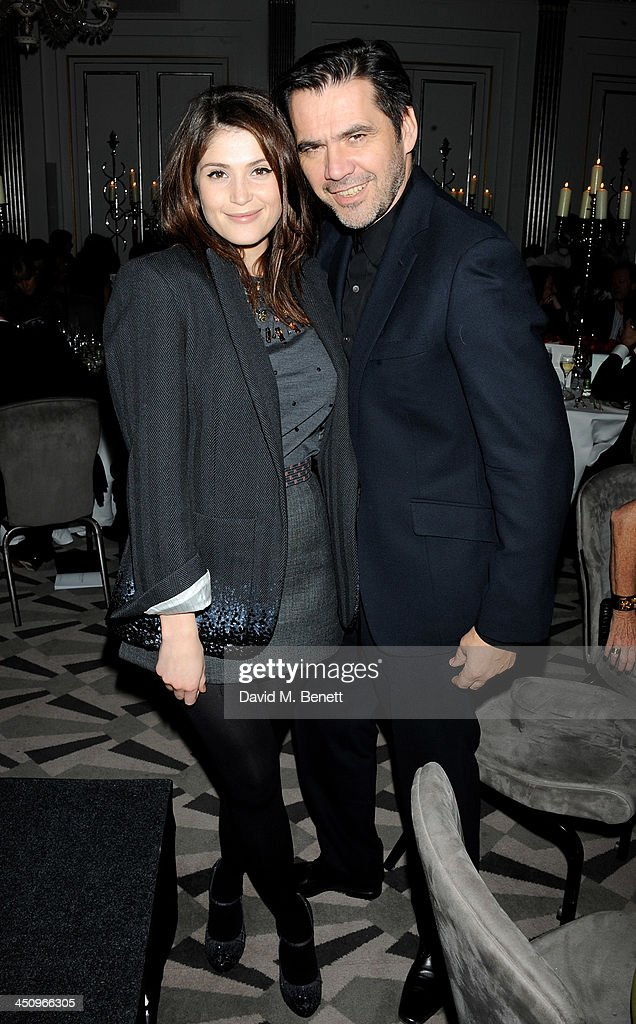 Gemma Arterton (L) and Roland Mouret attend the Isabella Blow: Fashion Galore! charity dinner hosted by the Isabella Blow Foundation at Claridges Hotel on November 19, 2013 in London, England.