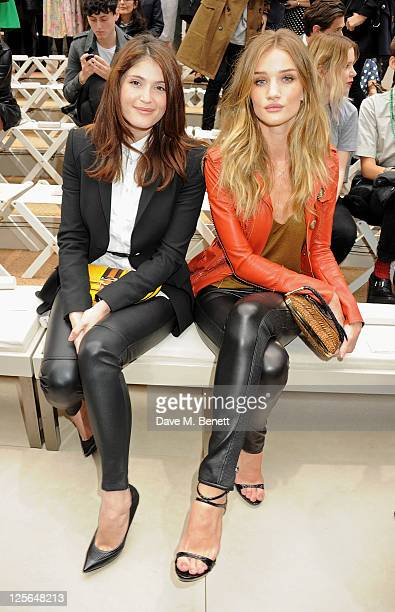 Gemma Arterton and Rosie HuntingtonWhiteley attend at the Burberry Spring Summer 2012 Womenswear Show at Kensington Gardens on September 19 2011 in...