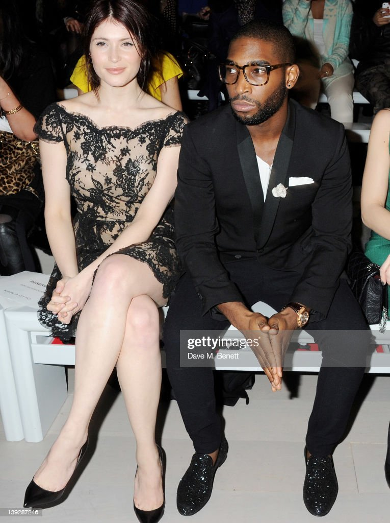 Gemma Arterton (L) and Tinie Tempah sit in the front row at the Issa London catwalk show during London Fashion Week Autumn/Winter 2012 at Somerset House on February 18, 2012 in London, England.