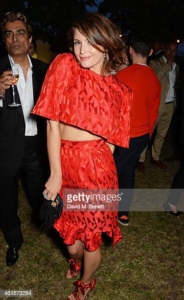 Gemma Arterton dances at The Serpentine Gallery Summer Party cohosted by Brioni at The Serpentine Gallery on July 1 2014 in London England