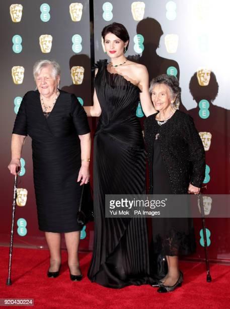 Gemma Arterton Eileen Pullen and Gwen Davis attending the EE British Academy Film Awards held at the Royal Albert Hall Kensington Gore Kensington...