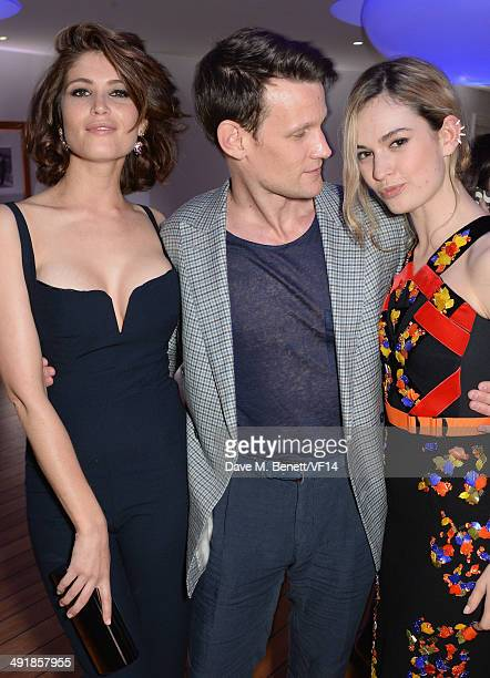 Gemma Arterton Matt Smith and Lily James attend the Vanity Fair And Armani Party at the 67th Annual Cannes Film Festival on May 17 2014 in Cap...