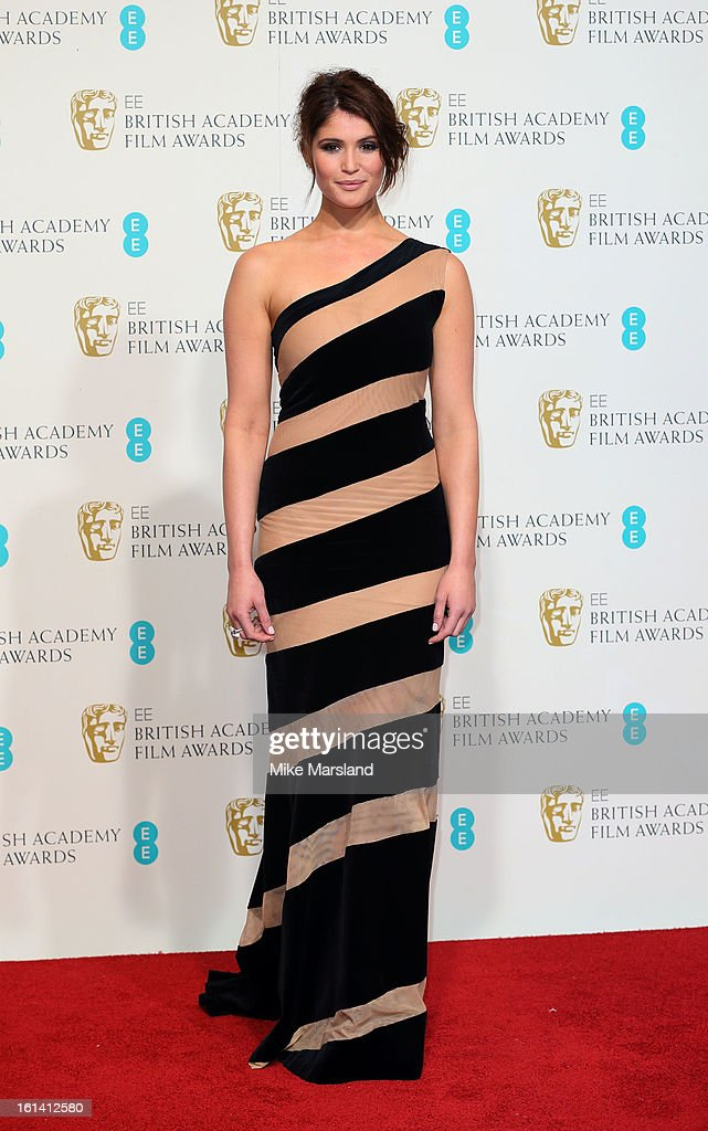 Gemma Arterton poses in the Press Room at the EE British Academy Film Awards at The Royal Opera House on February 10, 2013 in London, England.