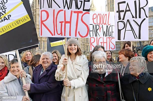 Gemma Arterton star of West End musical 'Made In Dagenham' and Reallife Dagenham strikers Gwen Davis Vera Simem Eileen Pullen and Sheila Douglass...