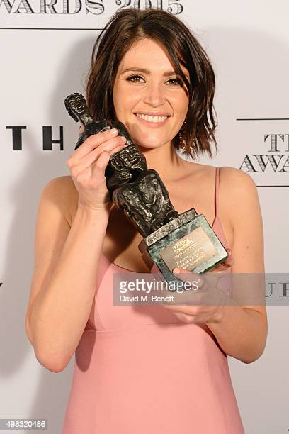 Gemma Arterton winner of the Newcomer in a Musical award poses in front of the Winners Boards at The London Evening Standard Theatre Awards in...