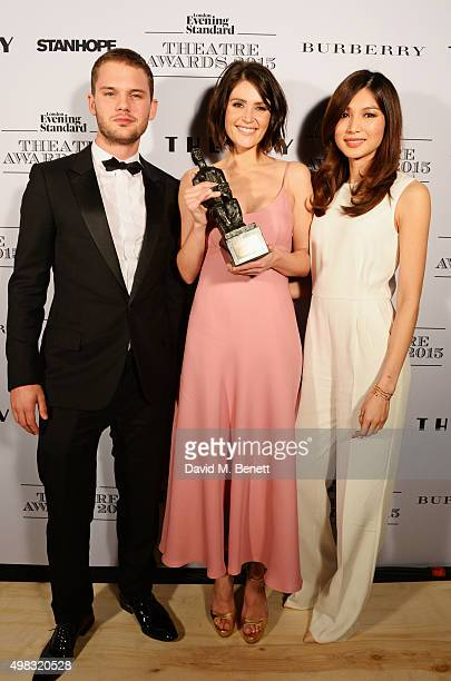Gemma Arterton , winner of the Newcomer in a Musical award, poses with presenters Jeremy Irvine and Gemma Chan in front of the Winners Boards at The...