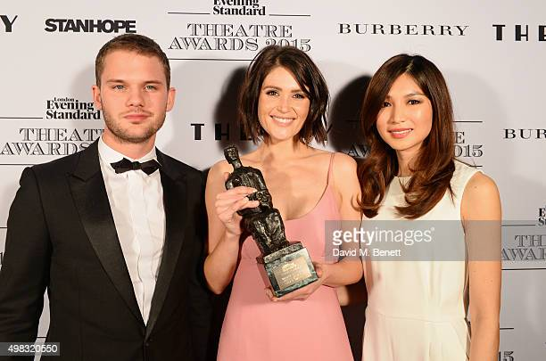 Gemma Arterton winner of the Newcomer in a Musical award poses with presenters Jeremy Irvine and Gemma Chan in front of the Winners Boards at The...