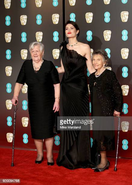 Gemma Arterton with Eileen Pullen and Gwen Davis at the EE British Academy Film Awards held at Royal Albert Hall on February 18 2018 in London England