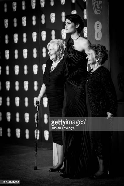 Gemma Arteton poses with the original Dagenham ladies Eileen Pullen and Gwen Davis as they attend the EE British Academy Film Awards held at Royal...