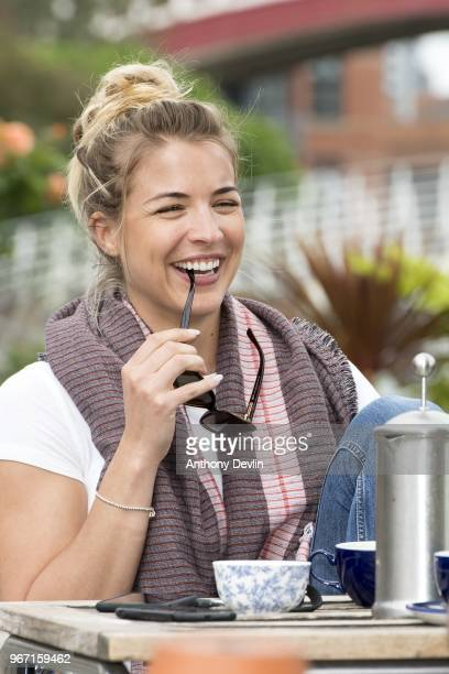 Gemma Atkinson smiles as she joins Gethin Jones and Dave Vitty from The Hits Radio as they celebrate the airing of their first show on June 4 2018 in...