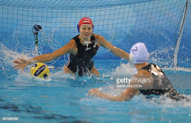 Gemma Beadsworth from Australia takes a shot for goal during a penalty shootout as Hungarian goalkeeper Patricia Horvath blocks during their women's...
