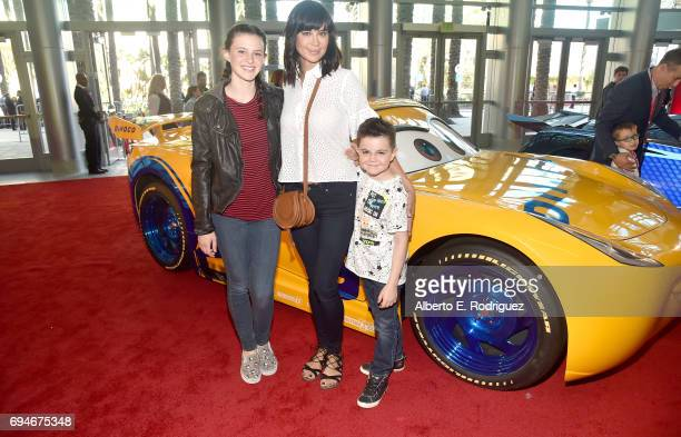"""Gemma Beason actor Catherine Bell and Ronan Beason pose at the World Premiere of Disney/Pixar's """"Cars 3 at the Anaheim Convention Center on June 10..."""