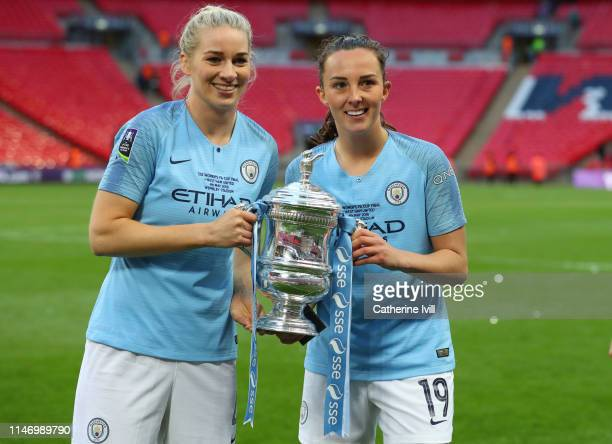 Gemma Bonner and Caroline Weir of Manchester City with the trophy after the Women's FA Cup Final match between Manchester City Women and West Ham...