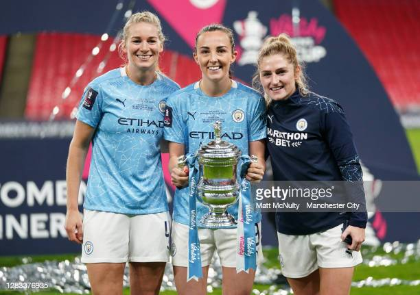 Gemma Bonner, Caroline Weir and Laura Coombs of Manchester City celebrate with the trophy during the Vitality Women's FA Cup Final match between...