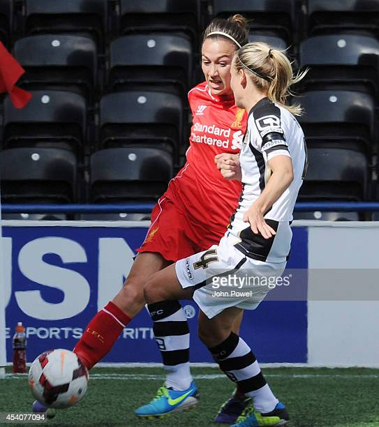Gemma Bonner of Liverpool fires past Katie Hoyle of Notts County at Select Security Stadium on August 24, 2014 in Widnes, England.