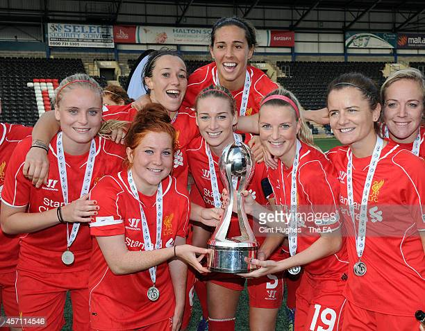 Gemma Bonner of Liverpool Ladies FC celebrates with her team-mates and the WSL trophy up after her sides victory during the FA WSL 1 match between...