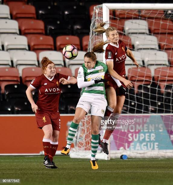 Gemma Bonner of Liverpool Ladies goes up with Kayleigh Green of Yeovil Town Ladiesbg during the FA Women's Super League match between Liverpool...