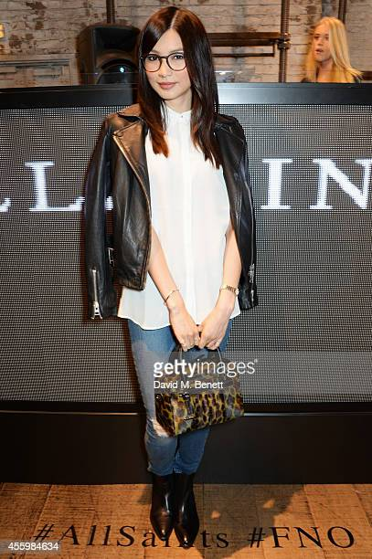 Gemma Chan attends Vogue Fashion's Night Out London 2014 at AllSaints Regent Street on September 23 2014 in London England