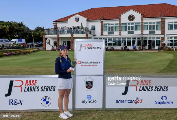 Gemma Clews of England holds the Rose Ladies Series trophy after her win in the Rose Ladies Series at Hillside Golf Club on August 02, 2021 in...