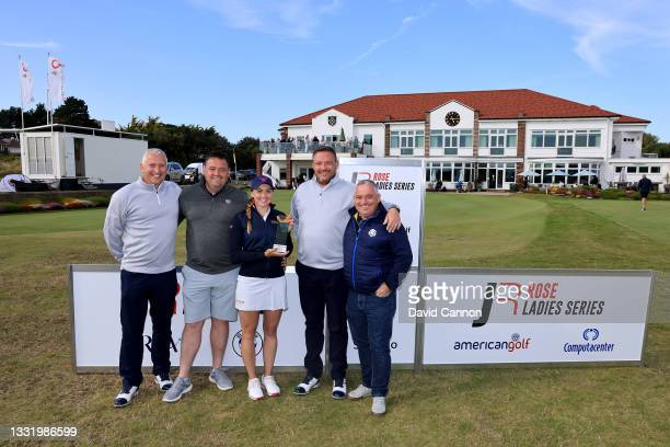 Gemma Clews of England holds the Rose Ladies Series trophy with members of her family and her coach after her win in the Rose Ladies Series at...
