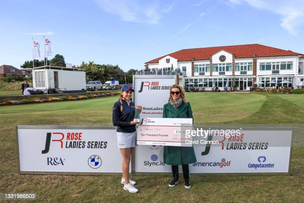 Gemma Clews of England is presented with the Rose Ladies Series trophy and winner's cheque by Kate Rose after her win in the Rose Ladies Series at...