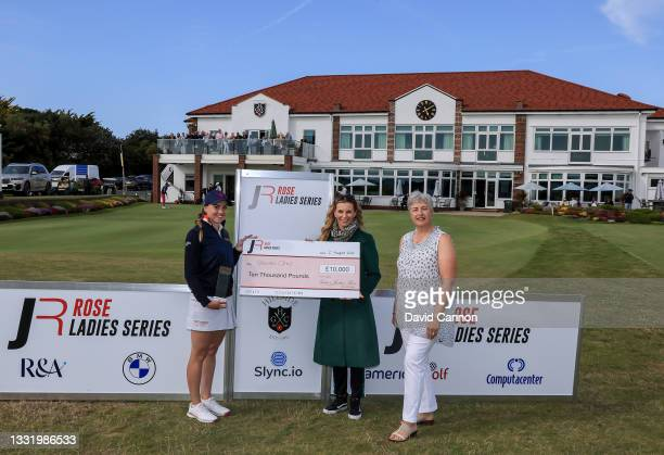 Gemma Clews of England is presented with the Rose Ladies Series trophy and winner's cheque by Kate Rose and the Hillside Golf Club Lady Captain after...