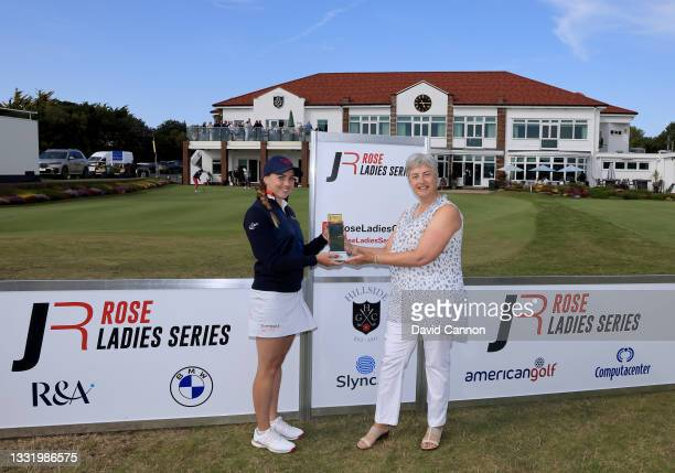 Gemma Clews of England is presented with the Rose Ladies Series trophy by the Hillside Golf Club Lady Captain after her win in the Rose Ladies Series...