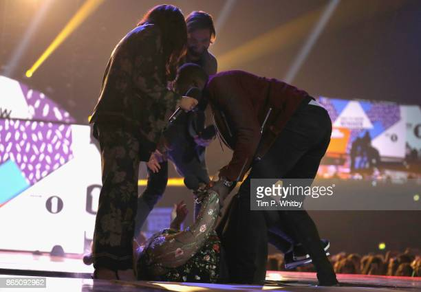 Gemma Collins is helped by Amber Davies Jamie Jewitt and Marcel Somerville as she falls on stage during the BBC Radio 1 Teen Awards 2017 at Wembley...