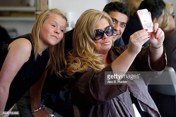 Gemma Collins of TOWIE takes a selfie as she is seen having Kapello Hair's PreTaped extensions applied at the Tikadi Salon on August 23 2014 in...