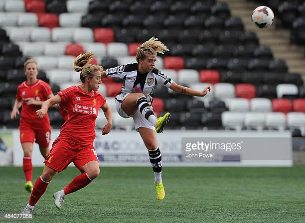 Gemma Davison of Liverpool moves in on Sophie Walton of Notts County at Select Security Stadium on August 24, 2014 in Widnes, England.