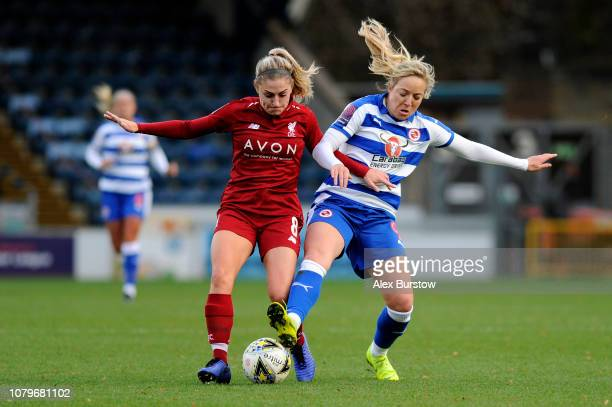 Gemma Davison of Reading battles for possession with Laura Coombs of Liverpool during the FA Women's Super League match between Reading FC Women and...