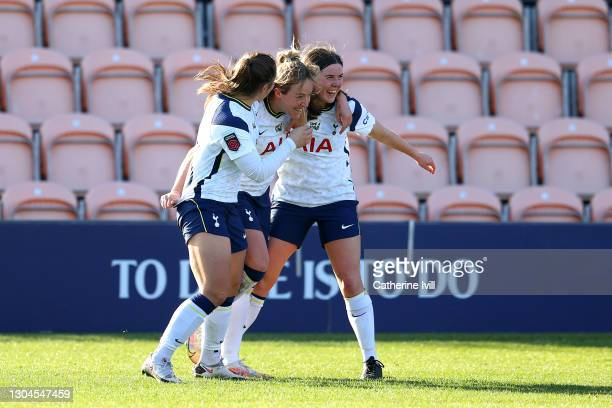 Gemma Davison of Tottenham Hotspur celebrates with team mates Kit Graham and Esther Morgan after scoring their side's second goal during the Barclays...