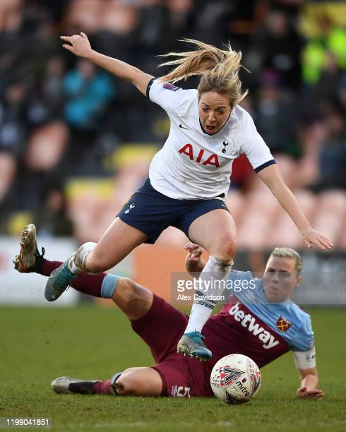 Gemma Davison of Tottenham Hotspur is tackled by Gill Flaherty of West Ham during the Barclays FA Women's Super League match between Tottenham...
